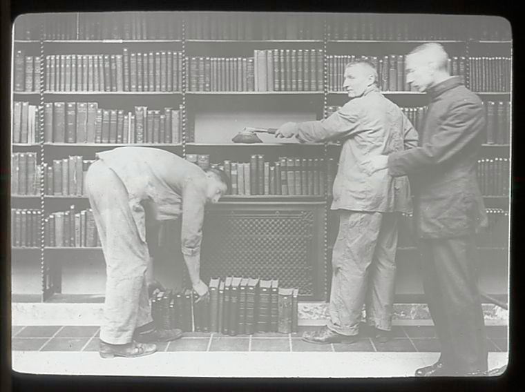 Three men dusting books. New York Public Libray