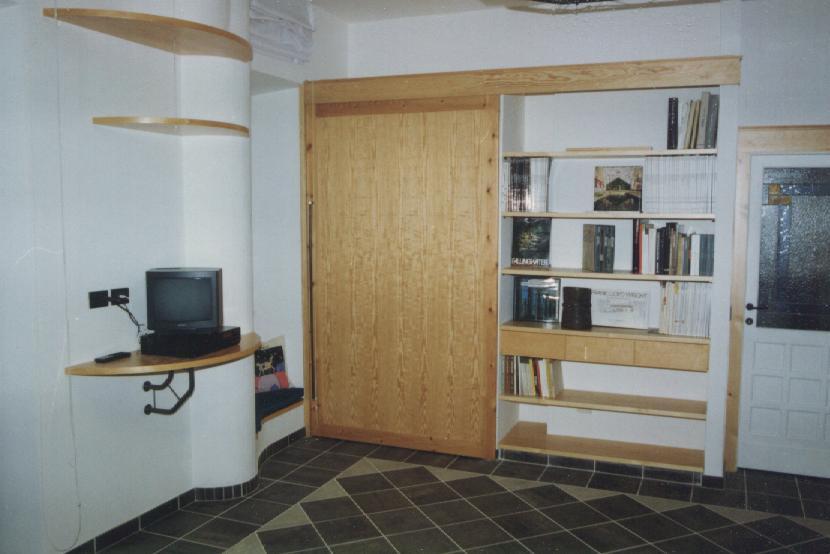 Falegnamarte soluzioni salvaspazio - Libreria divisoria con porta ...