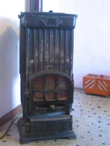 Foto stufa a legna usata in ghisa antica confronta prezzi for Stufa a legna in ghisa usata