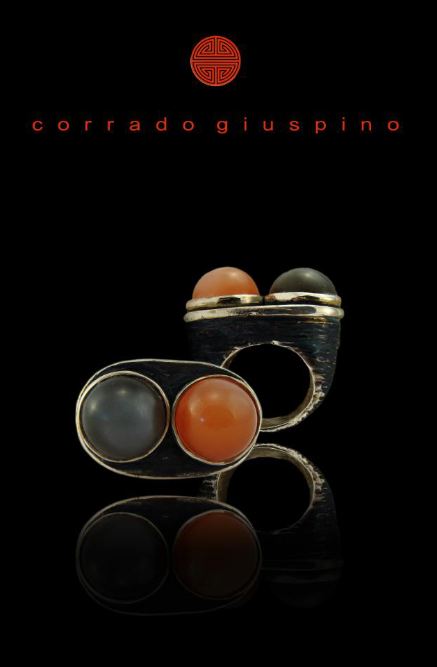http://digilander.libero.it/pinolopigna/Corrado%20Giuspino/Colours/Cocktail%20ring%20in%20argento%20brunito%20con%20pietre%20di%20luna%20cabochon.jpg